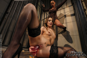 Andy Brown and Mandy Bright in a lezdom BDSM act