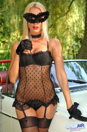 Blonde beauty posing and fingering on luxury car