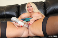 Big breasted Karen Fisher masturbates with a huge vibrator!