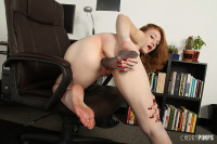 Redheaded Lucy Fire strips out of plaid skirt to masturbate!