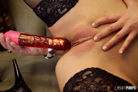 Sexy Abbey Brooks masturbates with red vibrator and her black stockings on!
