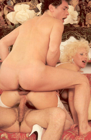 Hairy seventies lady receives two big cocks inside her twat