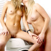 Two cute blonde teenagers doing the laundry fully naked