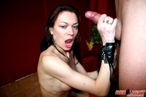 Slutty brunette hooker receives a load of cum on her face