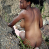Black teenage girl showing her big natural tits outdoor
