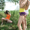 Three cute chicks posing naked outdoors in a grassy field