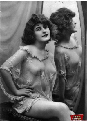 Vintage naked ladies looking in a mirror in the thirties