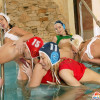 Sporting lesbians fondling eachothers soaked pussy in a pool