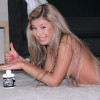 A horny and naked teenager enjoys playing with anal lube