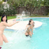 Hot teen lesbians licking and fucking each other in a pool