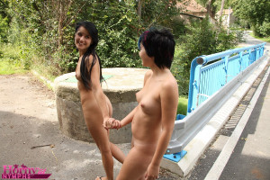Playful lesbian teens stripping and pussy play outdoors