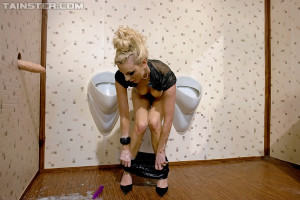 Spunk loving clothed beauty plays in a big public toilet