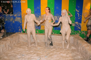 A couple of sexy horny girls playing in dirty gray slime