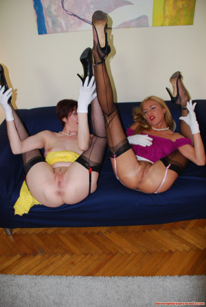 Pretty blonde and brunette enjoy fucking on a blue couch