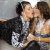 Two chicks playing with soaking spunk on their wet body