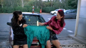 Pretty cute hotties becoming very dirty near a large car