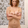 Naughty mature Maiky gets naked and dips her fingers in her hot mature pussy in the bathroom