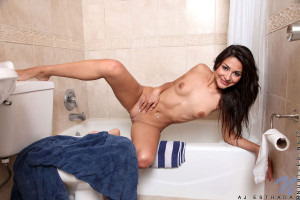 Pretty Nubile Aj Estrada gets her nude body in the bathtub and sprays with the shower