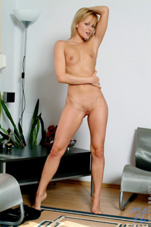Check this out naked dana spreads her pussy lips apart so you can see her clit while standing