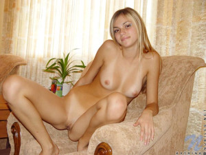 Sexy teen katrina sits and plays and poses on th floor