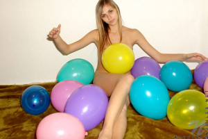 Katrina comfortably playing naked with this lovely colorful balloons
