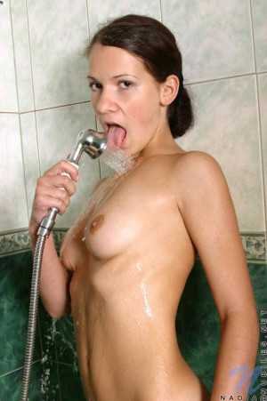 Cutie in the shower getting the water spray on her tiny boobies and nipples