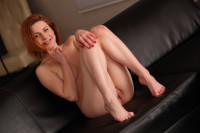 Stunning redhead toys her pussy with sex toys