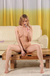 Naughty blonde Olivia pisses into a glass bottle