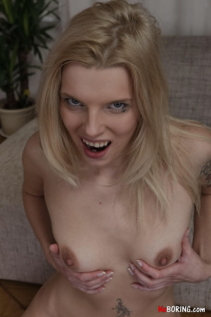 Mysterious blonde model with various tattoos in a hardcore fucking session