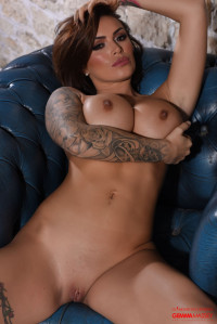 Gemma Massey strips naked from her black dress and lingerie