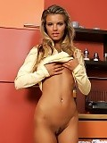 Flirty brunette cutie slowly strips and poses in kitchen