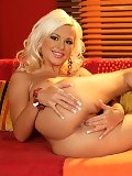 Blonde vixen lustily spreads and dildos pink snatch on couch