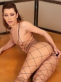 Vixen in fisnet poses fingers and dildos tight shaved pussy