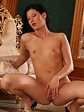 Sultry vixen spreads wet pussy and uses glass dildo on floor