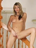 Busty hottie nudes and fucks rabbit vibrator on staircase