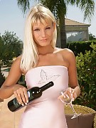 Luscious blonde sips wine and invitingly strips outdoors