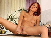 Sublime redhead strips spreads and dildos trimmed pussy