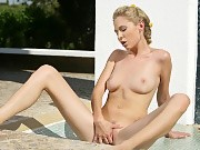 Sultry blonde gets wet and dildos pussy in outdoor shower