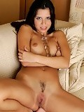 Stunning brunette strips buzzes clit and dildos trimmed twat