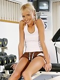 Sporty blonde strips spreads strong thighs and works out