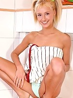 Cute blonde teen undresses and creams up her tight body