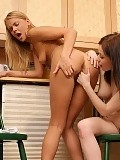 Teen cuties get naked and lap fresh twats in the kitchen