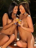 Sizzling hotties lustily tongue pussies on table outdoors