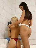 Blonde and brunette cuties strip rinse and lick pussies