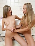 Fresh faced teens strip and finger bald pussies in bathroom