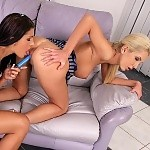 Gorgeous lesbians lick and dildo smooth pussies on couch