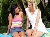 Sultry teens lap and finger slick pink pussies on pool chair