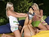 Four stunning teens rub and tongue fresh twats outdoors
