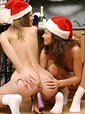 Cute teens in Santa hats nude and dildo fuck in kitchen