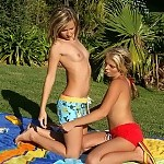 Tantalizng blondes strip and lick sweet pussies outdoors